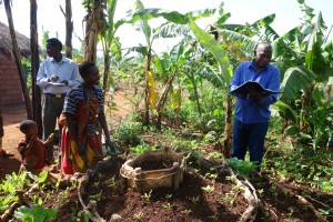 A Program Coordinator in Burundi checks in with a woman on the kitchen garden she recently constructed. (Courtesy: Episcopal Relief & Development)
