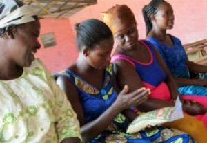 Women in northern Ghana discuss the merits of various maize seed varieties. (Courtesy: Episcopal Relief & Development)