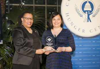 CHC Board Member Kimberly Perry presents award to Emerson National Hunger Fellow Alumna Christine Tran (Courtesy: CHC)